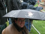 Terry hiding from the elements at a bangers race