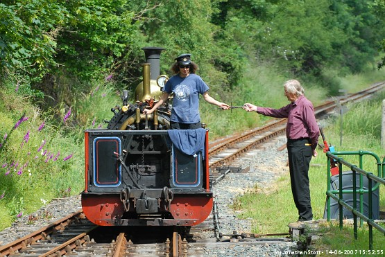 Exchanging tokens at Newmills Station on Launceston Steam Railway, Cornwall